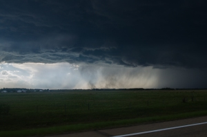 Dust being kicked up under large hail producing storm. South of Leduc